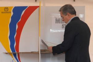 Election of Colombian Congress. President Alvaro Uribe exercising the right to vote. During his Presidency, Colombia has achieved many goals like reducing drugs trafficking and national stability.