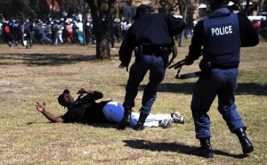 Police arrest an SANDF member during a protest in Pretoria in August 2009. Photo Phil Magakoe, Pretoria News
