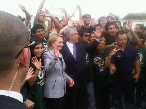 Secretary Clinton and President Elect Piñera at Santiago airport, visits with Chilean volunteers packing boxes with earthquake relief supplies.