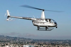 A similar helicopter to this monitored the suspect by using thermal equipment , during the standoff in Boston