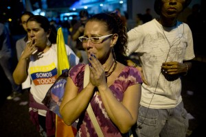 Opposition supporters react as they hear the official presidential elections results in Caracas, Venezuela, Sunday, April 14, 2013. Photo Credit AP Photo/Enric Marti