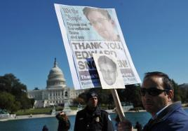 Demonstrators hold placards supporting former US intelligence analyst and pro russian defector Edward Snowden during a protest against government surveillance on October 26, 2013 in Washington, DC Photo Credit AFP/File, Mandel Ngan