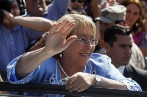 Now elected President in Chile, Michelle Bachelet waves to supporters after casting her vote during presidential elections in Santiago, Chile, Sunday, Dec. 15, 2013.