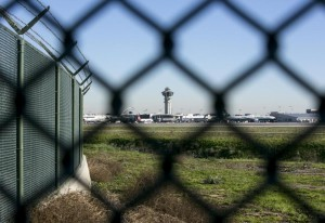 This Friday, Jan. 23, 2015 photo shows the Los Angeles International Airport control tower though the airport's perimeter fence. In the U.S., officials said there is neither the appetite nor funding to create fortress-like perimeters. And no solution is foolproof, according to airport security experts. (AP Photo/Damian Dovarganes)