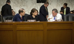 Senate intelligence committee chairman Richard Burr confers with committee vice-chair Dianne Feinstein and committee member Ron Wyden. Photograph Credit to : Pablo Martinez Monsivais/AP