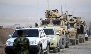 Armored vehicles of the US army move toward Mosul from the Hazer region during an operation Photograph credit to Anadolu Agency/Getty Images